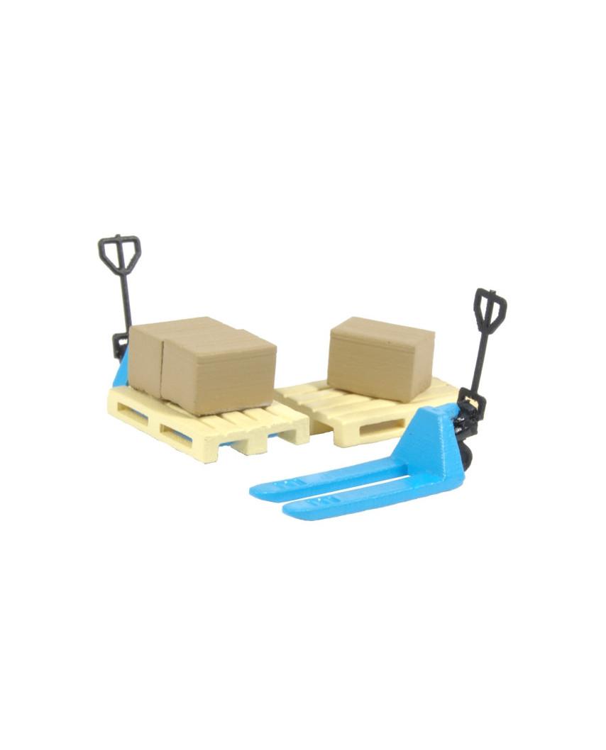 2 blue pallet jacks, 2 pallets and 3 cardboard boxes