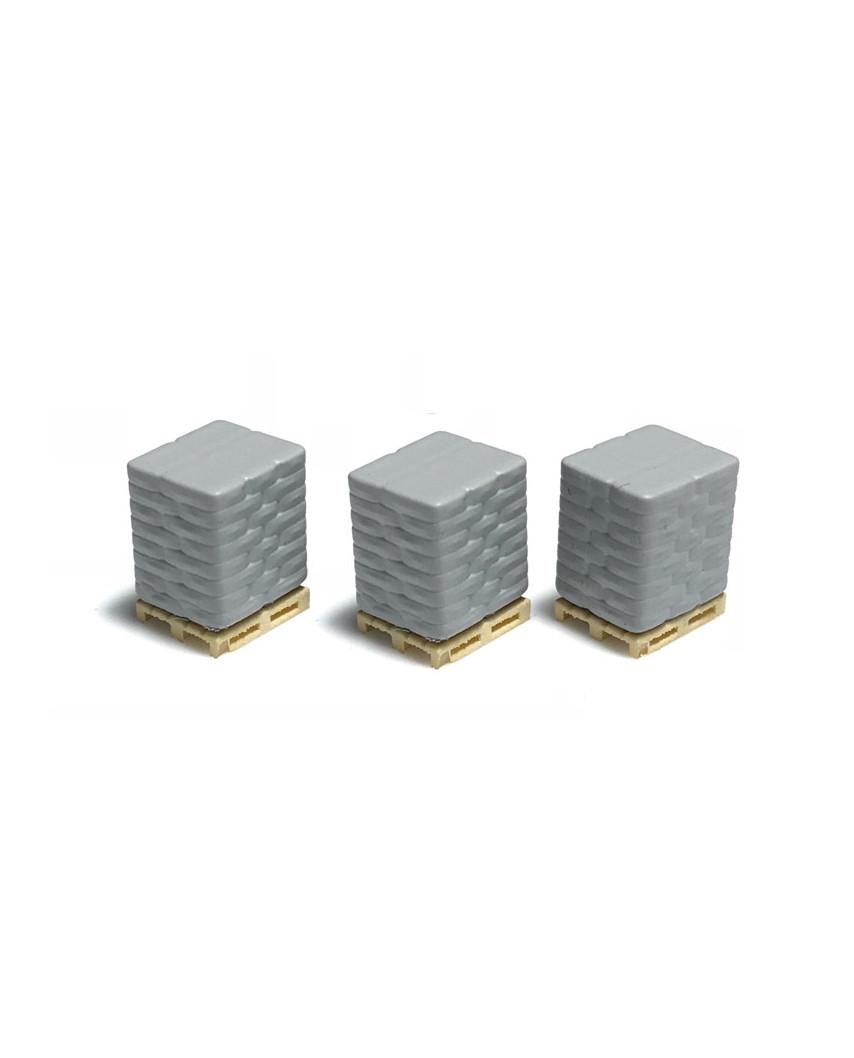 3 palés con sacos de cemento - gris