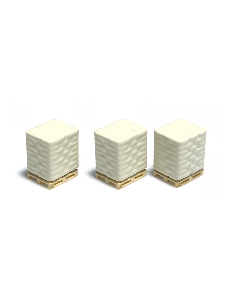 3 palés con sacos de cemento - blanco